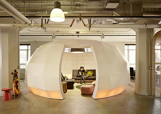A woman sitting in igloo-like meeting room at Runway inside the Twitter building.